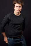 One handsome young man in jeans stock images
