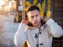 One handsome young man in city setting stock photography