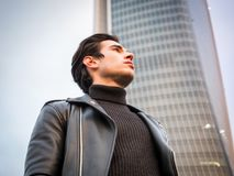 One handsome young man in modern city setting stock photo