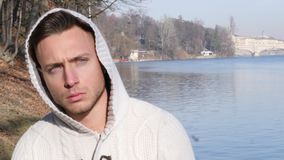 One handsome young man in urban setting in European city. Turin in Italy by the river Po, in cold winter day stock video
