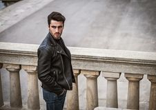 One handsome young man in modern city setting royalty free stock image