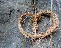 One hanging heart decoration wreath from aerial roots on big tree in the garden Royalty Free Stock Photos