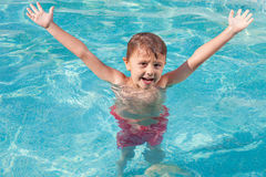 One happy child playing on the swimming pool at the day time. Royalty Free Stock Images