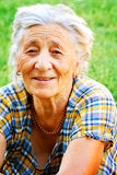 One happy content senior woman outdoor stock images