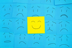 one happy face and sad around Royalty Free Stock Photo