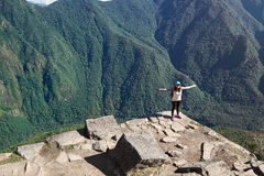 One happy girl on mountain peak. Woman came to peak of mountain Royalty Free Stock Images