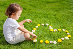 One happy little boy sitting on the grass Stock Photography