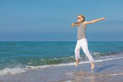 One happy little girl playing on the beach at the day time Royalty Free Stock Images