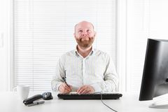 Happy and Thoughtful Office Worker Stock Photography