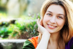 One happy young woman outdoor. Smile of happy young natural woman outdoor royalty free stock photo