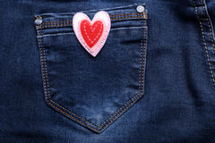 One heart on jeans background. One heart on jeans pocket, close-up royalty free stock photos