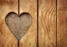 One heart shape carved in vintage wood close up Royalty Free Stock Photography