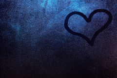 One heart shape draw. On frosty window glass texture background. Winter heart concept Royalty Free Stock Image