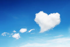 one heart shaped cloud on blue sky Stock Image