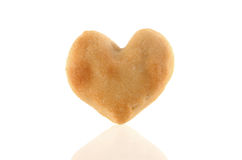 One Heart-shaped cookie with reflection Stock Photos