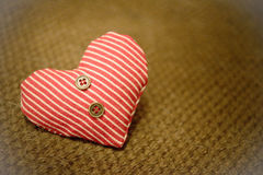 One heart textile with buttons on dark background Royalty Free Stock Photo