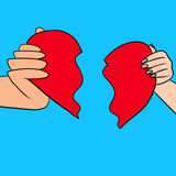 One heart, two parts. Man's and woman's hands, both holding a halves of a heart that matches perfectly Royalty Free Stock Photo