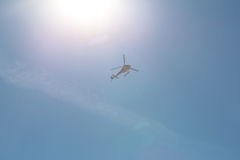 One helicopter hovering in sky Royalty Free Stock Images