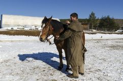 One horse and a man in front of horse barn. Selective focus Stock Photos