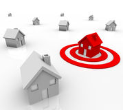 One House in Bulls-Eye Target - Marketing. One red house stands out in a neighborhood of white homes, sitting in a red target bullseye, symbolizing demographics Stock Image