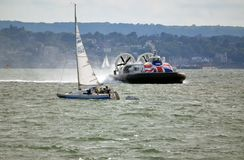 Hovercraft passing yacht, Island flyer, Southsea, Gosport to Ryde. Royalty Free Stock Photo