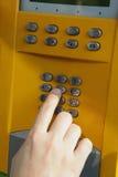 One human hand pressing key on phone Stock Photos