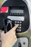 One human hand pressing key on phone Royalty Free Stock Photo
