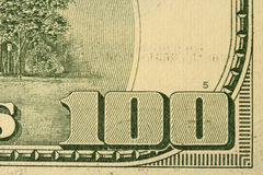 One hundred. Fragment of one hundred dollars bill with figure hundred (close-up Stock Photo