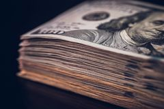 one hundred American dollar banknotes with band  Royalty Free Stock Photo