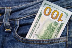 One hundred American dollars bill in the pocket of blue jeans Stock Photography