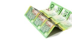 One hundred Australian dollar banknotes isolated on white backgr. Pile of one hundred Australian dollar banknotes isolated on white background Stock Photography