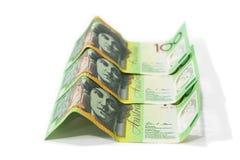 One hundred Australian dollar banknotes  on white backgr. Pile of one hundred Australian dollar banknotes  on white background Royalty Free Stock Image