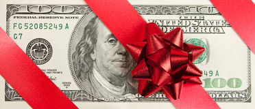 One hundred bill with red bow and ribbon Royalty Free Stock Photography