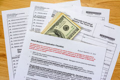 One hundred bills along with a marijuana checklist Stock Images