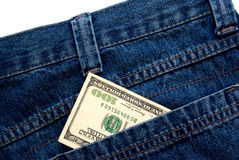 One hundred dollar. Banknote in a blue jeans pocket isolated over white Royalty Free Stock Image