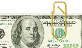 One hundred dollar banknote with golden paper clip on it close u Stock Photography