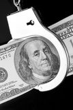 One hundred dollar banknote in handcuffs Royalty Free Stock Photos
