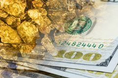 One hundred dollar banknotes on gold mine close up. Mining industry concept with dollars and gold.  stock image