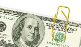 One hundred dollar banknotes with golden paper clip on it close up Royalty Free Stock Photography