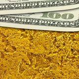 One hundred dollar banknotes on golden surface background close up. Royalty Free Stock Photos