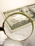 One hundred dollar bill. Hundred dollar bill with magnifying glass Stock Photo
