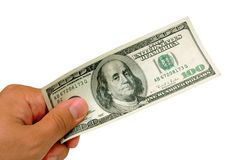 One hundred dollar bill. Male hand holding a one hundred dollar bill - CLIPPING PATH INCLUDED Stock Photo