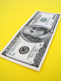 One Hundred Dollar Bill. S - on yellow background Stock Photography