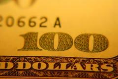 One hundred dollar bill. One hundred dollar. macro photo in the yellow light Royalty Free Stock Photos
