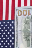 One hundred Dollar bill on American flag Royalty Free Stock Image