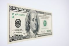 One Hundred Dollar Bill. Angle shot of a $100 dollar bill with selective focus and shallow depth of field Stock Photography