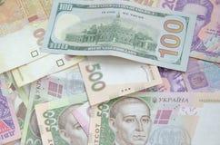 One hundred dollar bill on the background of ukrainian hryvnia. Royalty Free Stock Image