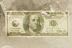One Hundred Dollar Bill Behind Cracked Ice Royalty Free Stock Photos