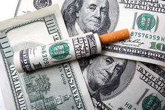 One hundred dollar bill and cigarette Royalty Free Stock Images