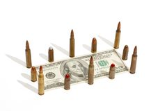 One hundred dollar bill fenced by cartridges Royalty Free Stock Image
